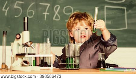 Fascinating Subject. Knowledge Day. Kid Study Biology Chemistry. Boy Microscope And Test Tubes Schoo