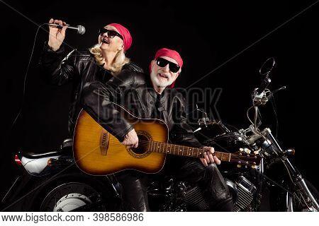Photo Of Aged Bikers Man Lady Duet Couple Sit Chopper Moto Rock Bike Festival Meeting Play Sing Guit