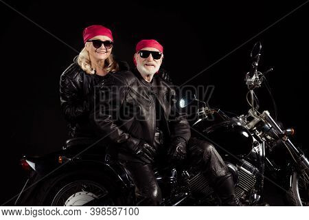 Photo Of Two Aged Bikers Grey Hair Man Lady Couple Sit Vintage Chopper Moto Feel Young Rock Festival