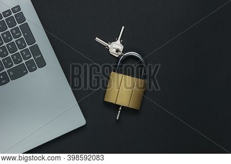 Online Security. Internet Protection. Password For Computer. Laptop And Padlock With Key On Black Ba