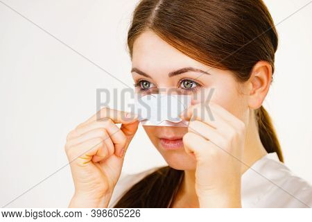 Woman Appying Clear-up Strips On Nose, Using Pore Cleansing Textile Mask Girl Taking Care Of Skin Co