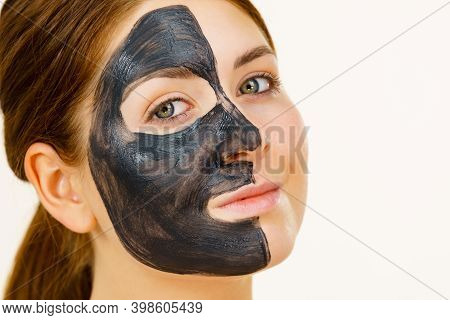 Woman With Charcoal Facial Mask