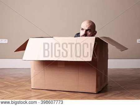 man comes out of a box