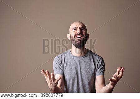 portrait of young man screaming in despair