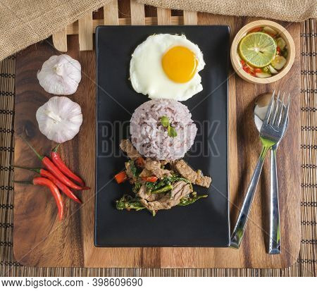 Stir-fried Beef Basil With Fried Egg And Riceberry Rice.