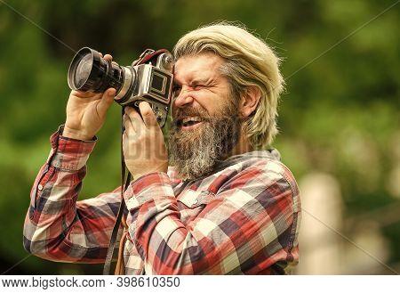 Man Bearded Hipster Photographer Hold Vintage Camera. Man With Beard Shooting Photos. Photographer C