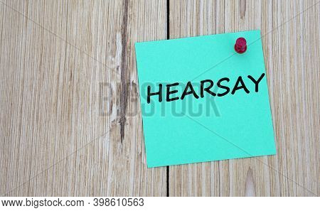 Hearsay - Word Written On A Green Sheet For Notes, Which Is Pinned To A Light Wooden Board. Info Con