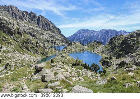 Barbs And Munyidera Lake At Summer, Aigües Tortes And Estany Of Sant Maurici National Park, Lleida,