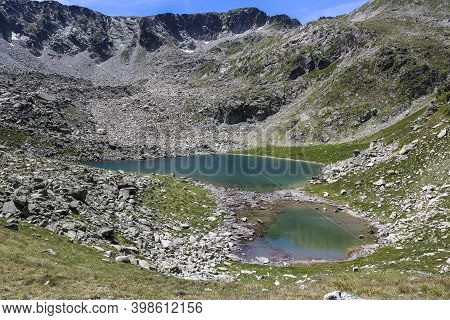 Aigües Tortes And Estany Of Sant Maurici National Park At Summer.