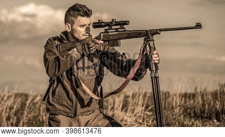 Hunter Man. Shooter Sighting In The Target. Hunting Period. Hunter With Hunting Gun And Hunting Form