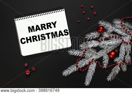 Flat Lay Composition With Notebook With The Inscription Marry Christmas, Silver Spruce Branch, Chris
