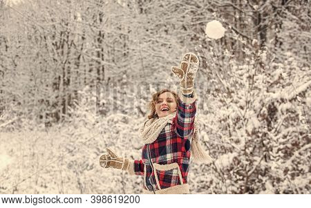 Real Feelings. Winter And People Concept. Having Snowball Fight. Happy Woman Play Snowball Outdoor.