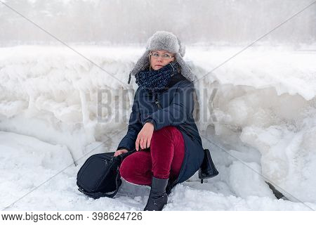 Woman On The Background Of A Winter Landscape With Large Hummocks, Frozen Ice, Jurmala, Latvia. Wint
