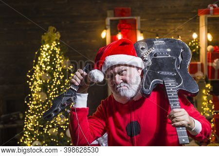 New Year. Santas Delivery. Santa Claus With Broken Guitar. Santa Costume. Christmas Time. Christmas.