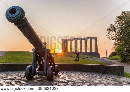 View Of National Monument Of Scotland Against Sunset On Calton Hill In Edinburgh, Scotland