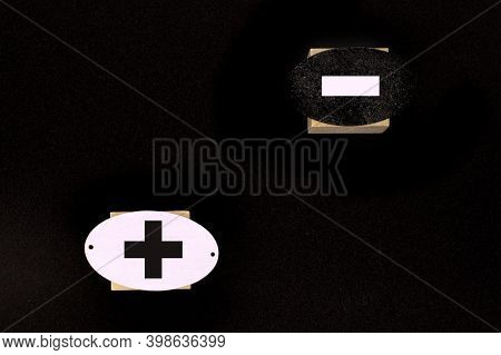Symbols Of Black Color Plus And Minus On Wooden Cubes