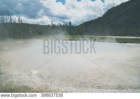 Green Spring, Extremely Steamy, In The Black Sand Geyser Basin In Yellowstone National Park