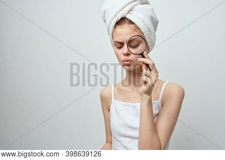 Woman With Magnifying Glass In Hand And Acne On Her Face With A Towel On Her Head Acne