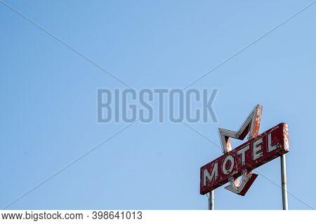 Negative Space Composition Of A Vintage Motel Sign