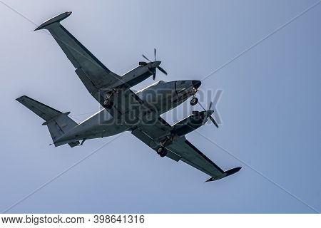 Large Propeller-driven Transport Aircraft At Air Show . Large Propeller-driven Aircraft