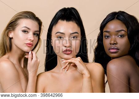 Three Amazing Beautiful Women Of Different Nationalities, Caucasian, Asian And African, With Nude Ma