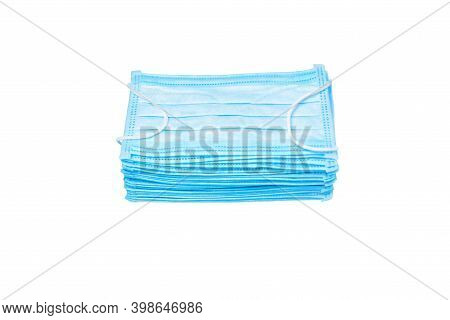 Pile Of Blue Medical Mask Isolated On White Background. Stack Mask. Pile Mask. Disposable Face Masks