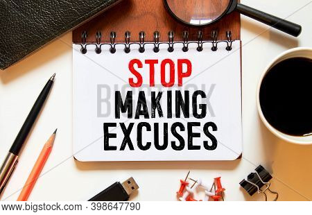 Stop Making Excuses Text Written On A Notebook With Pencils.