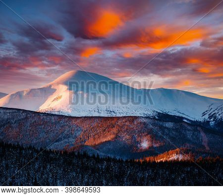 Incredible sunset in a mountain valley on a frosty evening. Location place of Carpathian mountains, Ukraine, Europe. Vibrant photo wallpaper. Image of a bright epic sky. Discover the beauty of earth.