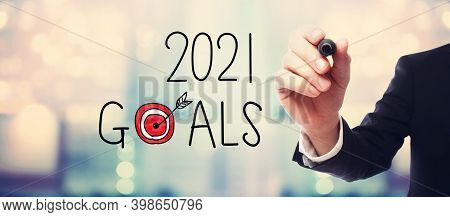2021 Goals With Businessman On Blurred Abstract Background