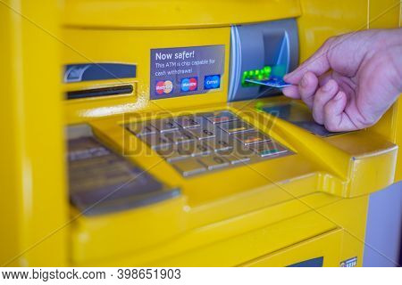 Bangkok, Thailand - June 22, 2017: Man's Hand Inserting A Credit Card In Atm With