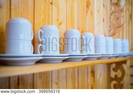 Served Crockery On Wooden Shelve Ready For Use