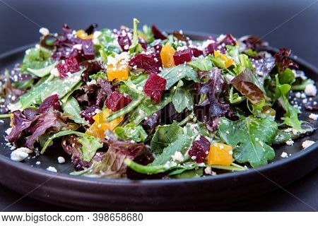 Delicious Hearty Bowl Of Beets And Arugula Salad Makes The Mouth Water And The Stomach Growl.