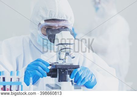 Male Scientist Look Into Microscope Research In Science Laboratory. Asian Scientist Looking Equipmen