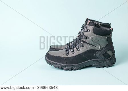 Insulated Mens Stylish Walking Shoes For Travel On A Blue Background. Mens Shoes For Cold Weather. C