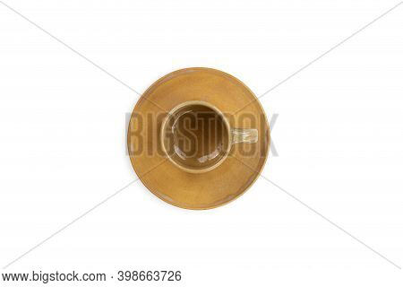 Brown Porcelain Tea Cup On Saucer Isolated On White Background. With Clipping Path. Top View.