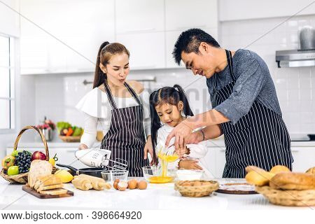 Portrait Of Enjoy Happy Love Asian Family Father And Mother With Little Asian Girl Daughter Child Ha