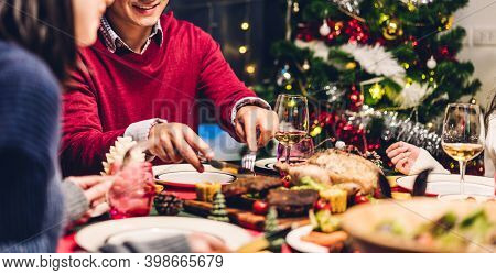 Portrait Of Happy Big Family Celebrating Santa Hats Having Fun And Lunch Together Enjoying Spending