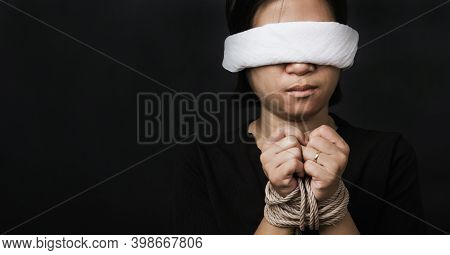 Slave Asian Woman Tied With Chains And Closed Her Eyes Black Background. Freedom Speech Censorship A