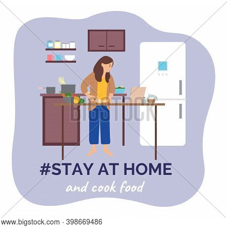 Self Isolation, Stay At Home Concept, Young Woman Cooking In The Kitchen Using Laptop Surfing Intern