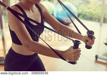 Fit Woman Workout Triceps Lifting Weights In Gym. Athletic Woman Doing Exercise Using Machine In Gym