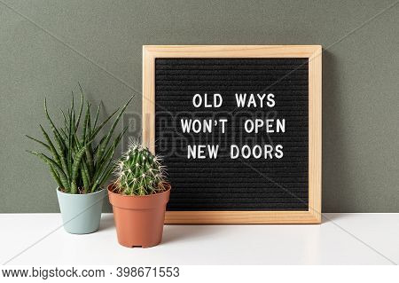 Old Ways Wont Open New Doors. Motivational Quote On Letter Board, Cactus, Succulent Flower On White