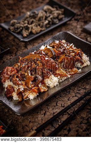 Traditional Chinese Food, Beef With Bamboo And Shiitake In Brown Sauce