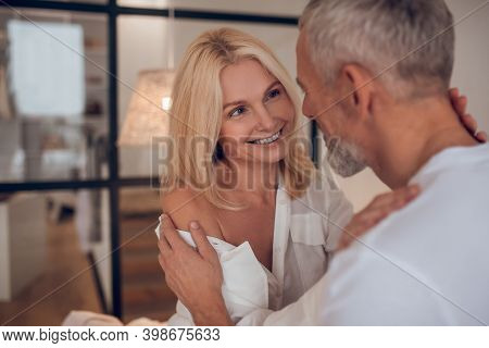 Mature Couple Looking At Each Other And Feeling In Love