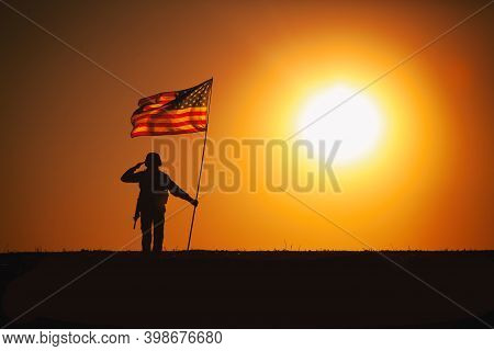 Silhouette Of Usa Armed Forces Soldier, Army Infantryman Or Marine Corps Fighter Saluting While Stan
