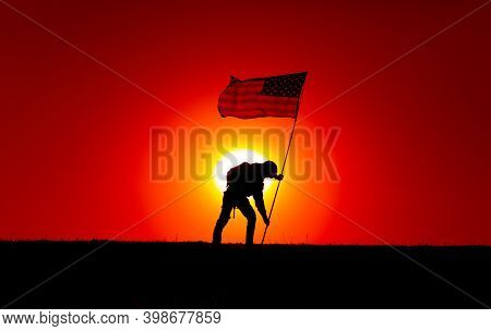 Silhouette Of Army Soldier, United States Of America Infantryman Sticking Into Ground Flagpole With