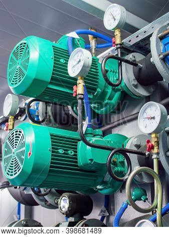 Manometer, Pipe, Heat Insulation, Flow Meter, Water Pumps And Valves Of Heating System In A Boiler R