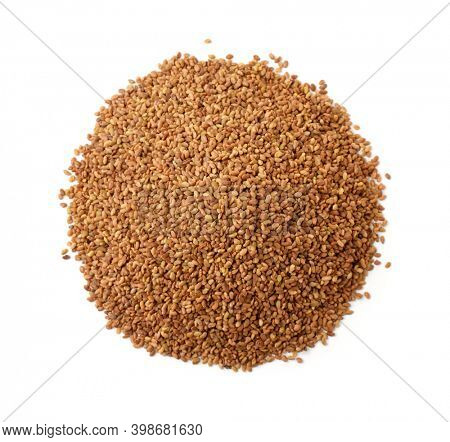Top view of organic alfalfa seeds isolated on white