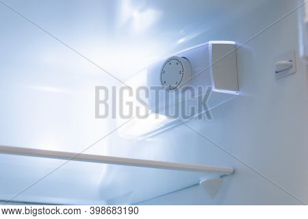 Temperature Regulator Inside The Refrigerator And Lamp For Lighting Inside When Opening The Door