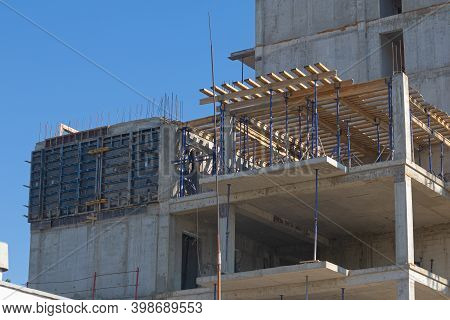 Installation Of The Ceiling In A Multi-storey Panel Building Under Construction. Supporting Beams An