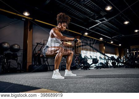 Athletic Woman Doing The Full-body Cardio Workout